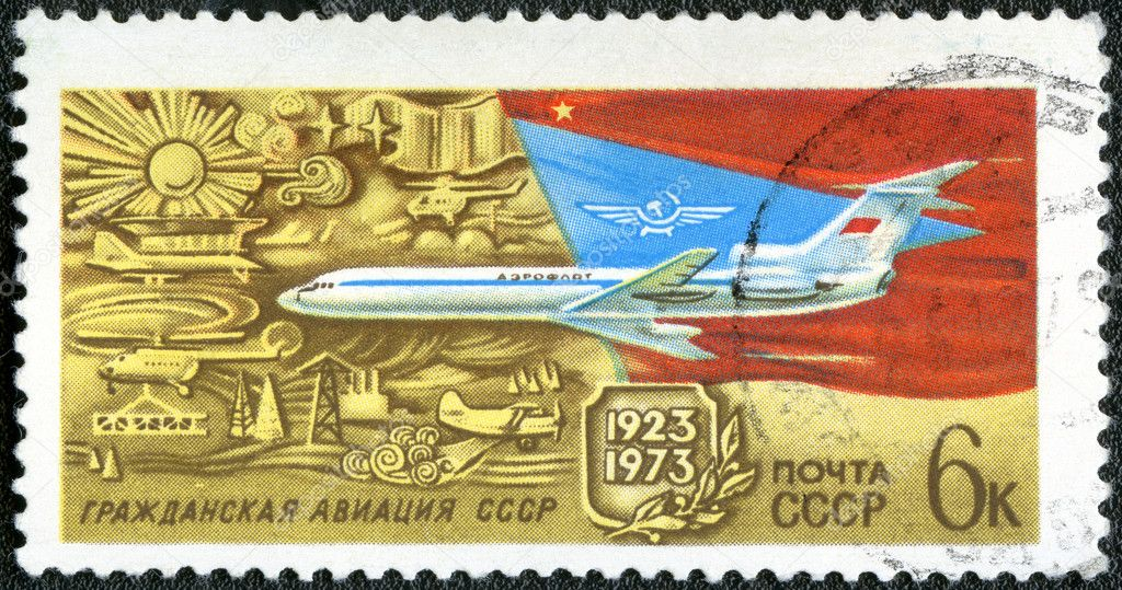 USSR - CIRCA 1973: A stamp printed in USSR shows TU-154 Turbojet Passenger Plane, 50th anniversary of Soviet Civil Aviation, circa 1973  Stock Photo #11821817
