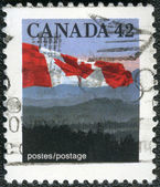 CANADA - 1990: shows Canadian flag and Hills — Zdjęcie stockowe
