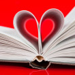 Pages of a book curved into a heart shape — Foto de Stock