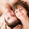 Stock Photo: Young happy couple in bed