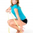 Happy woman on weight scale — Stock Photo #11350641