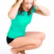 A young girl screams as she sees her weight on the scale — Stock Photo #11350654