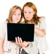Two young businesswomen working on laptop. — Stock Photo #11350864