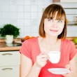 Young woman enjoying a cup of coffee — Stock Photo #11351125