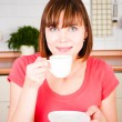 Young woman enjoying a cup of coffee — Stock Photo #11351129