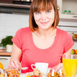 Beautiful woman having a healthy breakfast — Stock Photo #11351165