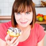 Young woman enjoying a doughnut — Stock Photo #11351205