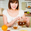 Young beautiful happy woman with tea — ストック写真