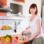 Woman preparing something to eat — Stock Photo #11351331