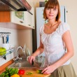 Stock Photo: Wompreparing something to eat
