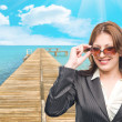 Business woman on background of pier — Stock Photo