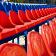 Stock Photo: Red plastic seats in stadium.