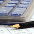 Stock Photo: Close-up of fountain pen and calculator