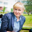 Outdoor portrait of serious beautiful blond woman — Stock Photo #11352252