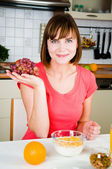 Young happy woman with grapes — Stock Photo