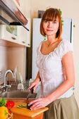 Woman preparing something to eat — Stock Photo