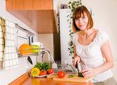 Home life: woman preparing something to eat — Stock Photo