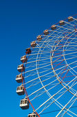 Ferris wheel on blue background — Stock Photo
