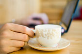 Hand with cup of coffee. — Stock Photo
