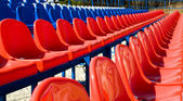 Red plastic seats in the stadium. — Stock Photo