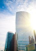 Modern buildings with sun — Stock Photo