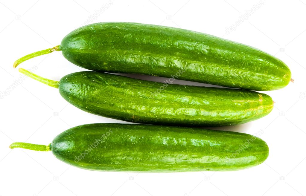Healthy food. The green cucumbers isolated on white background  Stock Photo #11350346