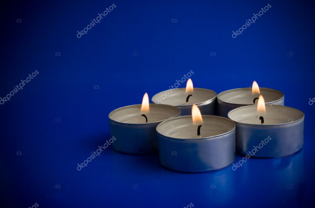 Candles on blue background  Stock Photo #11350909