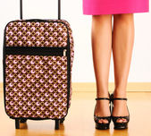 Woman with travel suitcase — Stockfoto