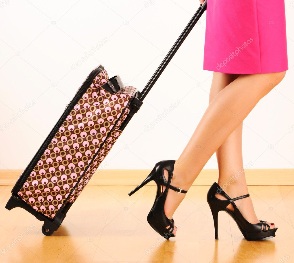 Woman's legs and travel suitcase — Stock Photo #11171955