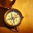 Antique brass compass over old background — Stock Photo