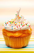 Cupcake with whipped cream — Stock Photo