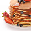 Pancakes with strawberry and blueberries — Stock Photo #11390356
