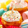 Cupcakes with whipped cream — Stock Photo #11390431