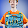 Stock Photo: Repairmwith his toolkit