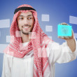 Young arab pressing virtual buttons — Stockfoto