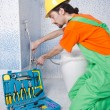 Plumber working in the bathroom - 