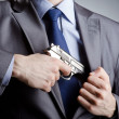 Businessman man with hand gun - Stock Photo