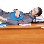 Businessman sleeping at this desk — Stock Photo