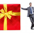 Businessman with gift boxes on white - Stock fotografie