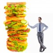 Man and giant sandwich on white — Stock Photo #11077942
