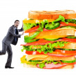 Man and giant sandwich on white — Stock Photo #11077958