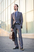 Young businessman on the street — Stock Photo