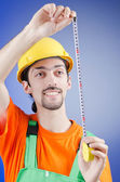 Repairman with measuring tape — Stock Photo