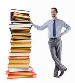 Businessman with books on white — Stock Photo