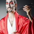 Japanese actor with chopsticks — Foto de stock #11173952