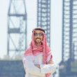 Arab on seaside in traditional clothing — Stock Photo