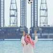 Arab with footbal at seaside — Stock Photo