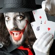 Joker with cards in studio shoot — Stock Photo #11174605
