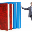 Businessman with books on white - Stock Photo