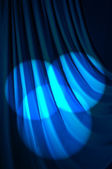 Brightly lit curtains in theatre concept — Stock Photo